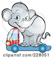 Royalty Free RF Clipart Illustration Of A Cute Elephant On A Lorry Truck by Lal Perera