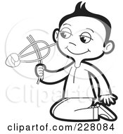 Royalty Free RF Clipart Illustration Of A Coloring Page Outline Of A Sinhala Boy Playing With A Toy