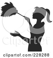 Royalty Free RF Clipart Illustration Of A Brown Silhouetted Maid Dusting With A Feather Duster by Pams Clipart