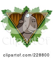 Royalty Free RF Clipart Illustration Of An Ape Face Over A Safari Triangle With Leaves by Cory Thoman
