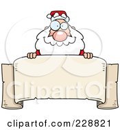 Santa Looking Over A Blank Banner
