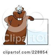 Royalty Free RF Clipart Illustration Of A Gopher Leaning Against A Blank Sign by Cory Thoman