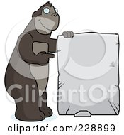 Royalty Free RF Clipart Illustration Of An Ape Holding Up A Stone Sign by Cory Thoman