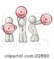Group Of Three White Men Holding Red Targets In Different Positions