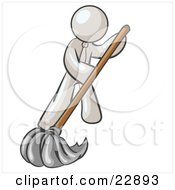White Man Wearing A Tie Using A Mop While Mopping A Hard Floor To Clean Up A Mess Or Spill