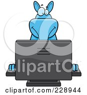 Royalty Free RF Clipart Illustration Of A Blue Aardvark Using A Desktop Computer by Cory Thoman