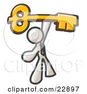 White Businessman Holding A Large Golden Skeleton Key Symbolizing Success