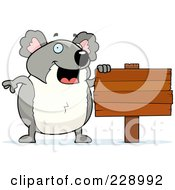 Royalty Free RF Clipart Illustration Of A Koala Standing By A Blank Wooden Sign