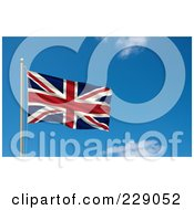 Royalty Free RF Clipart Illustration Of The Flag Of UK Waving On A Pole Against A Blue Sky