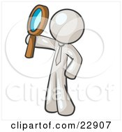 White Man Holding Up A Magnifying Glass And Peering Through It While Investigating Or Researching Something