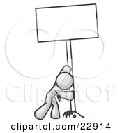 Strong White Man Pushing A Blank Sign Upright