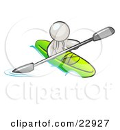 White Man Paddling Down A River In A Green Kayak