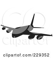 Royalty Free RF Clipart Illustration Of A Silhouetted Airliner 2