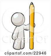White Man Holding Up And Standing Beside A Giant Yellow Number Two Pencil