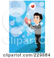Happy Man Holding A Heart Over Blue