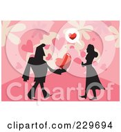 Silhouetted Man Giving A Woman A Heart Over Pink
