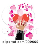 Mans Hand Holding A Red Heart Over Pink And White