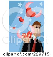 Businessman Holding A Winged Heart On Blue