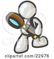 White Man Bending Over To Inspect Something Through A Magnifying Glass