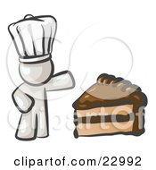 Clipart Illustration Of A White Chef Man Wearing A White Hat And Presenting A Tasty Slice Of Chocolate Frosted Cake