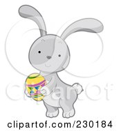 Royalty Free RF Clipart Illustration Of A Cute Gray Rabbit Holding An Easter Egg