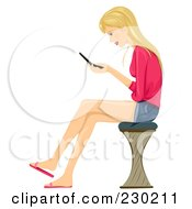 Teen Girl Sitting On A Stool And Texting On Her Cell Phone