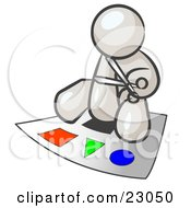 Clipart Illustration Of A White Man Holding A Pair Of Scissors And Sitting On A Large Poster Board With Colorful Shapes