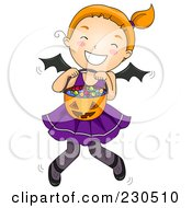 Cute Halloween Girl In A Bat Costume Holding Her Candy