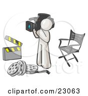 Clipart Illustration Of A White Man Filming A Movie Scene With A Video Camera In A Studio