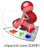 Red Man Holding A Pair Of Scissors And Sitting On A Large Poster Board With Colorful Shapes