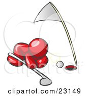 Clipart Illustration Of A Red Man Down On The Ground Trying To Blow A Golf Ball Into The Hole by Leo Blanchette
