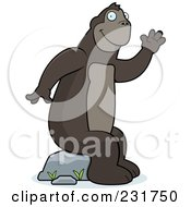 Royalty Free RF Clipart Illustration Of A Friendly Ape Waving And Sitting On A Boulder by Cory Thoman