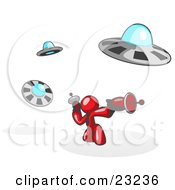 Clipart Illustration Of A Red Man Fighting Off UFOs With Weapons