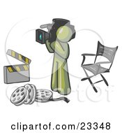 Clipart Illustration Of An Olive Green Man Filming A Movie Scene With A Video Camera In A Studio
