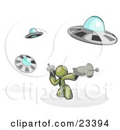 Clipart Illustration Of An Olive Green Man Fighting Off UFOs With Weapons by Leo Blanchette