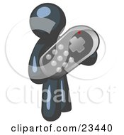 Navy Blue Man Holding A Remote Control To A Television