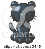 Clipart Illustration Of A Cute Navy Blue Kitty Cat Looking Curiously At The Viewer