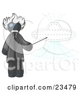 Navy Blue Einstein Man Pointing A Stick At A Presentation Of A Flying Saucer