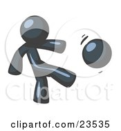 Clipart Illustration Of A Navy Blue Man Kicking A Ball Really Hard While Playing A Game