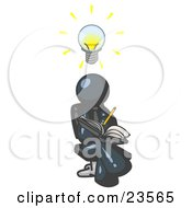 Smart Navy Blue Man Seated With His Legs Crossed Brainstorming And Writing Ideas Down In A Notebook Lightbulb Over His Head