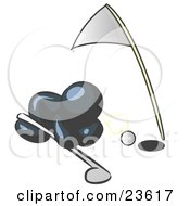 Clipart Illustration Of A Navy Blue Man Down On The Ground Trying To Blow A Golf Ball Into The Hole