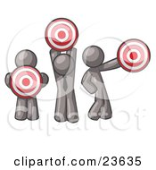 Clipart Illustration Of A Group Of Three Gray Men Holding Red Targets In Different Positions