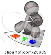 Clipart Illustration Of A Gray Man Holding A Pair Of Scissors And Sitting On A Large Poster Board With Colorful Shapes