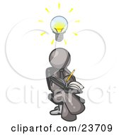 Smart Gray Man Seated With His Legs Crossed Brainstorming And Writing Ideas Down In A Notebook Lightbulb Over His Head