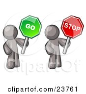 Gray Men Holding Red And Green Stop And Go Signs by Leo Blanchette