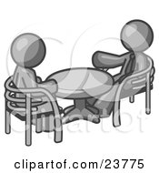 Two Gray Business Men Sitting Across From Eachother At A Table During A Meeting by Leo Blanchette