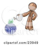 Brown Man Using A Watering Can To Water New Grass Growing On Planet Earth Symbolizing Someone Caring For The Environment