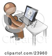 Clipart Illustration Of A Brown Doctor Man Sitting At A Computer And Viewing An Xray Of A Head