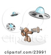 Clipart Illustration Of A Brown Man Fighting Off UFOs With Weapons by Leo Blanchette