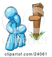 Clipart Illustration Of An Uncertain Light Blue Man And Child Standing At A Wooden Post Trying To Decide Which Direction To Go At A Crossroads